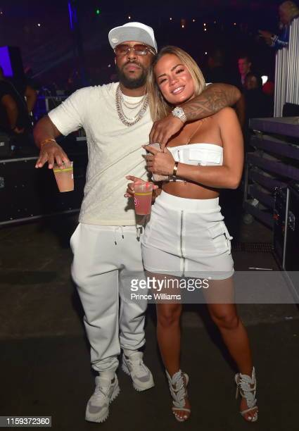 Rapper Rocko and Halle Calhoun backstage at Hot 1079 Birthday Bash 2019 at State Farm Arena on June 15 2019 in Atlanta Georgia