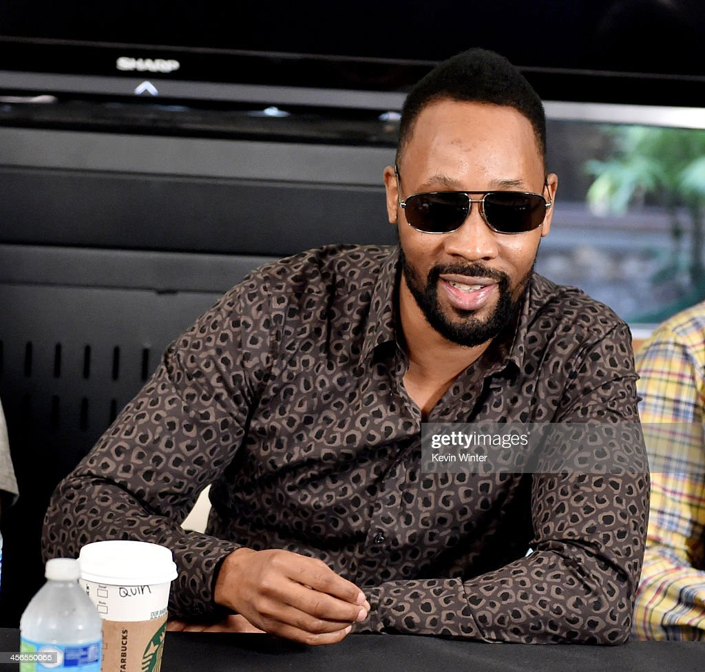 Rapper RZA of the Wu-Tang Clan poses at a press conference to announce they have signed with Warner Bros. Records at Warner Bros. Records on October 2, 2014 in Burbank, California.