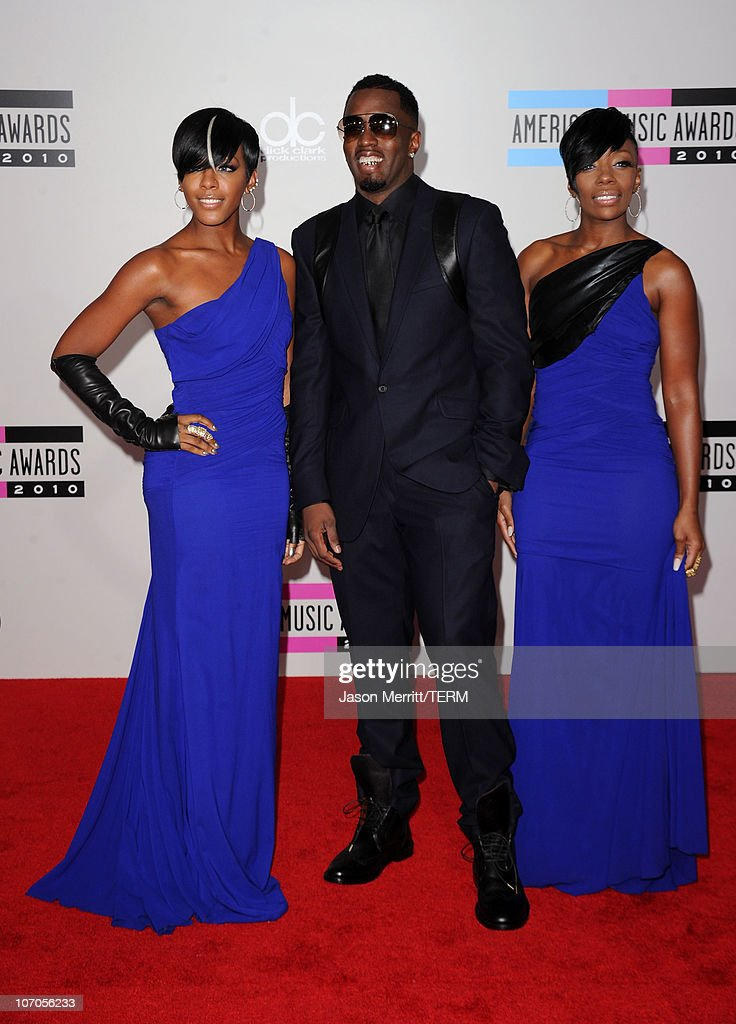 Rapper Sean 'Diddy' Combs and singers Dawn Richard (L) and Kalenna Harper from the musical group Dirty Money arrive at the 2010 American Music Awards held at Nokia Theatre L.A. Live on November 21, 2010 in Los Angeles, California.