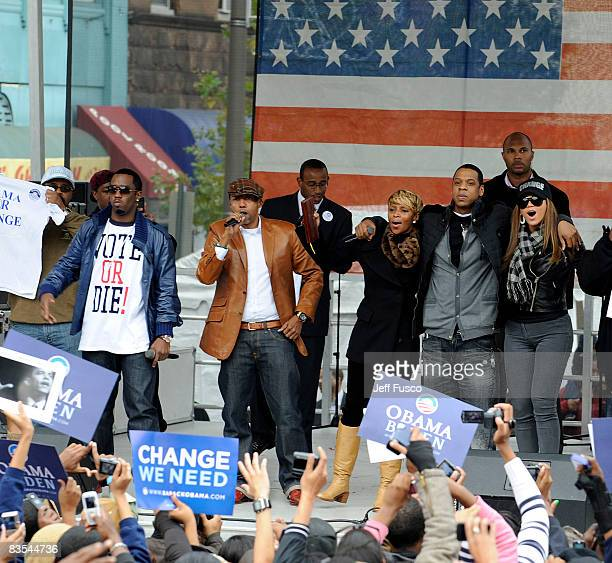 Rapper Sean Diddy Combs record executive Kevin Liles singer Mary J Blige and rapper JayZ are seen at a Promote The Vote Block Party in support of...