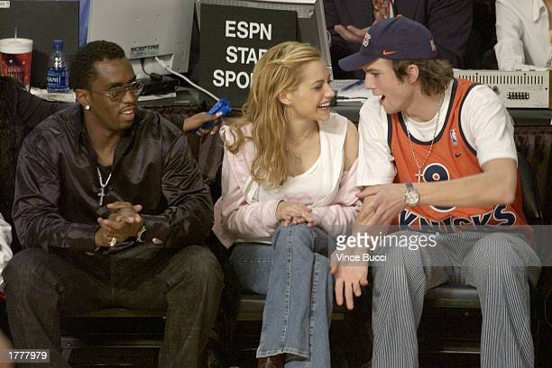 Rapper Sean P Diddy Combs actress Brittany Murphy and actor Ashton Kutcher sit court side during the 2003 NBA AllStar game at the Phillips Arena...