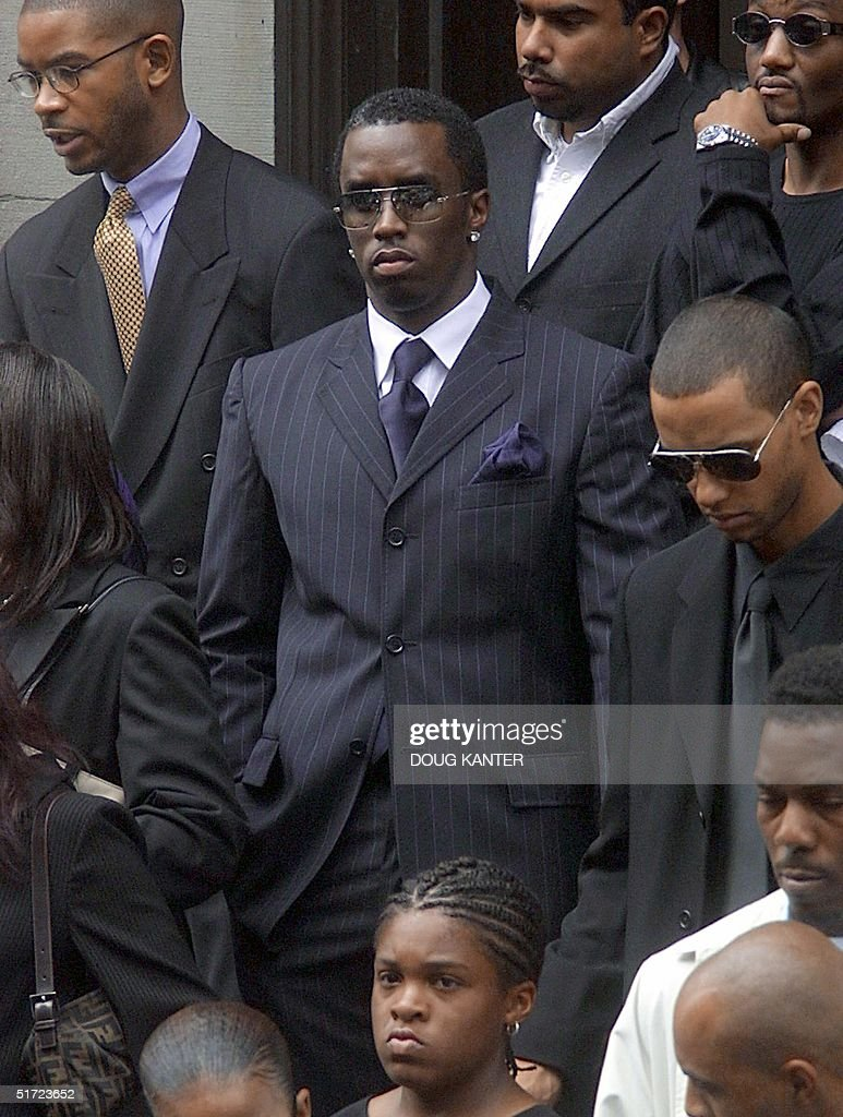 "Rapper Sean ""Puffy"" Combs (C) leaves the funeral o : News Photo"