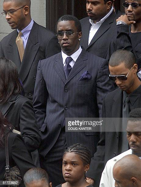 Rapper Sean Puffy Combs leaves the funeral of RB star Aaliyah at St Ignatius Loyola Church 31 August 2001 in New York Aaliyah died in a plane crash...
