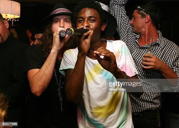 Rapper Shwayze and musician Cisco Adler perform while actor and musician Simon Rex dances during Travis McCoy's birthday celebration at Country Club...