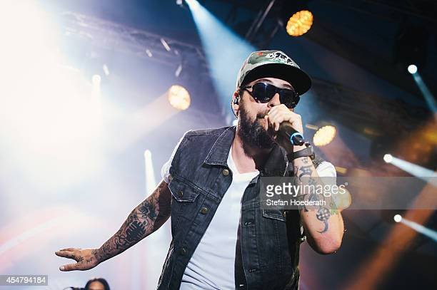 Rapper Sido performs live on stage during 'Die Neuen Deutschpoeten Open Air Festival' at IFA Sommergarten on September 6 2014 in Berlin Germany