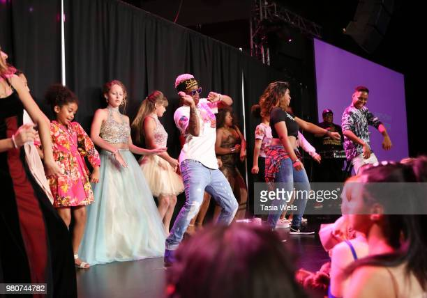 Rapper Silento and musical artist Tyeler Reign perform onstage at Jillian Estell's red carpet birthday party with a purpose benefitting The Celiac...