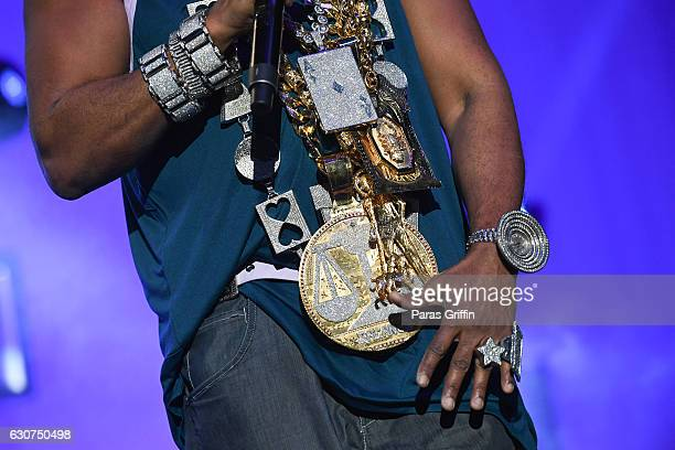 Rapper Slick Rick jewelry detail performs onstage at 2016 Old School Hip Hop New Year's Eve Festival at Philips Arena on December 31 2016 in Atlanta...