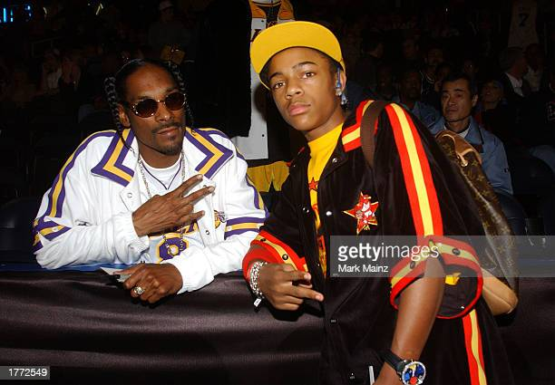 Rapper Snoop Dogg and rapper Bow Wow wait for the start of the at the 2003 NBA AllStar game at the Phillips Arena February 9 2003 in Atlanta Georgia