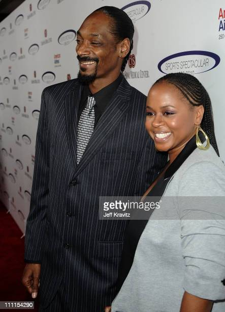 Rapper Snoop Dogg and Shante Broadus arrive at the 25th Anniversary Of CedarsSinai Sports Spectacular held at Hyatt Regency Century Plaza on May 23...