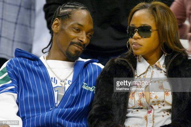 Rapper Snoop Dogg and wife Shante Taylor watch the Los Angeles Lakers game against the Miami Heat at the Staples Center December 25 2004 in Los...