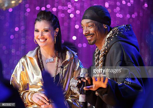 Rapper Snoop Dogg appears onstage with host Lyndsey Rodrigues during MTV's Total Request Live at the MTV Times Square Studios on March 11 2008 in New...