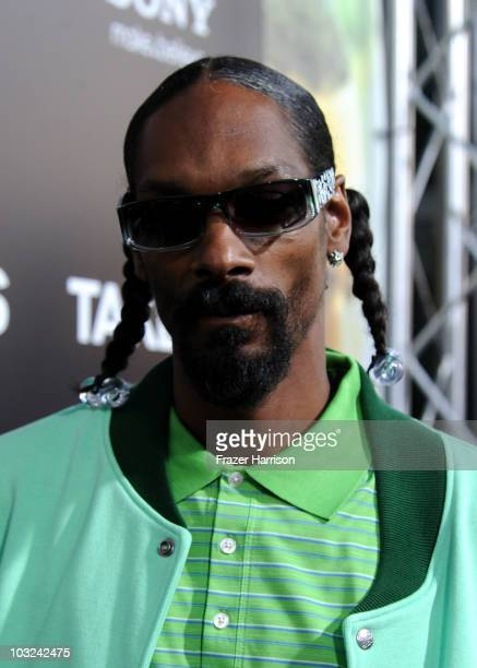 Rapper Snoop Dogg arrives at Screen Gems' 'Takers' premiere at Arclight Cinema Cinerama Dome on August 4 2010 in Hollywood California