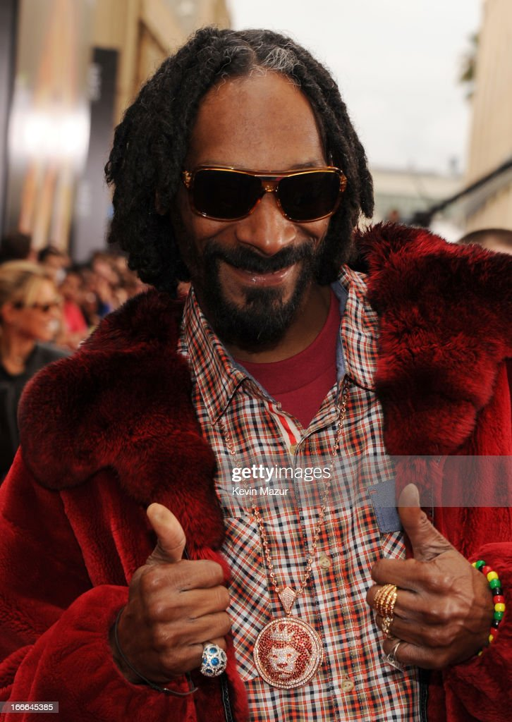 Rapper Snoop Dogg arrives at the 2013 MTV Movie Awards at Sony Pictures Studios on April 14, 2013 in Culver City, California.