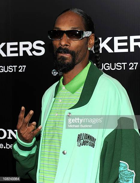 Rapper Snoop Dogg arrives at the premiere of Screen Gems' Takers at the Arclight Cinerama Dome on August 4 2010 in Hollywood California