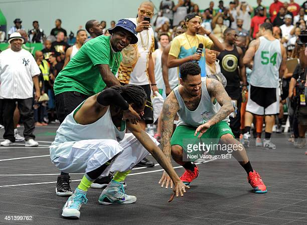 Rapper Snoop Dogg NFL player DeSean Jackson and singer Chris Brown attend the Sprite Celebrity Basketball Game during the 2014 BET Experience At LA...