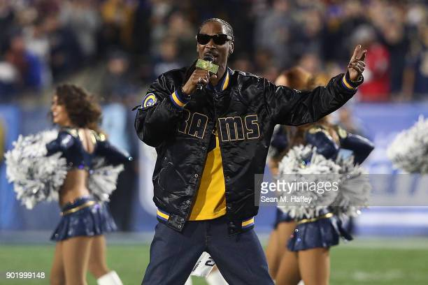 Rapper Snoop Dogg performs during halftime at the NFC Wild Card Playoff Game between the Los Angeles Rams and Atlanta Falcons at the Los Angeles...