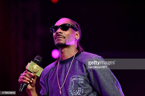 Rapper Snoop Dogg performs onstage during the Ice Cube Kendrick Lamar Snoop Dogg Schoolboy Q AbSoul Jay Rock concert at Staples Center on June 27...