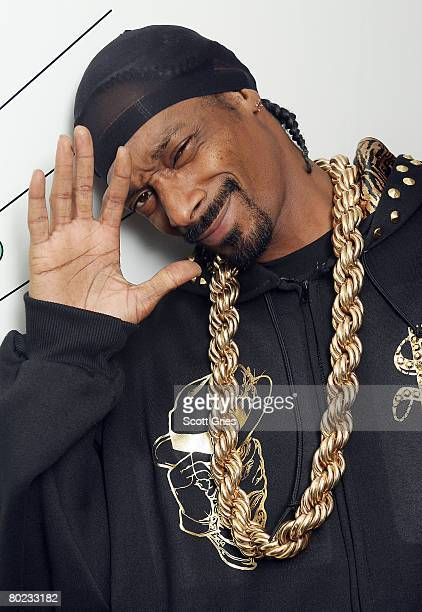 Rapper Snoop Dogg poses for a photo backstage during MTV's Total Request Live at the MTV Times Square Studios on March 11 2008 in New York City