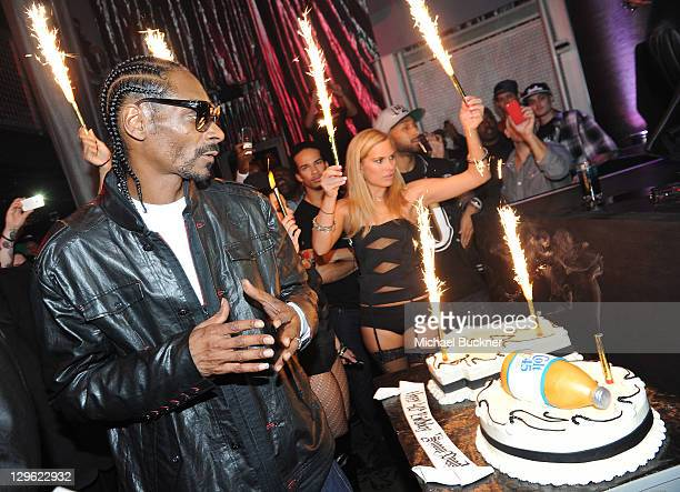 Rapper Snoop Dogg poses with his Sweet E's Bake Shop cake at 40th Birthday Party at The Rolling Stone Lounge on October 18 2011 in Hollywood...