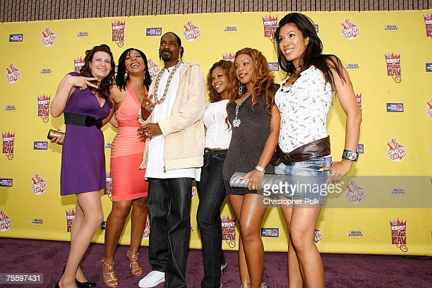 Rapper Snoop Dogg poses with the 'Flavor of Love Girls Charm School' contestants Becky 'Buckwild' Johnston former contestand Deelishis Larissa...