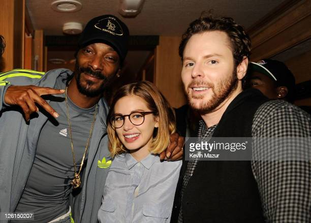 Rapper Snoop Dogg singersongwriter Alexandra Lenas and entrepreneur Sean Parker pose backstage at Sean Parker's Celebration of Music on September 22...