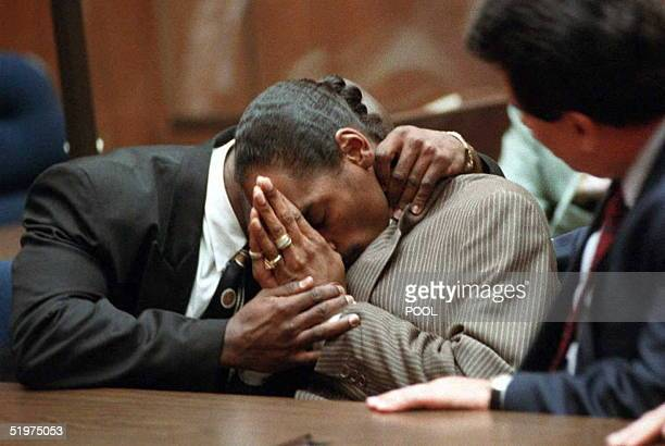 Rapper Snoop Doggy Dogg whose real name is Clavin Broadus holds his head after hearing the notguilty verdict 20 February on first and seconddegree...