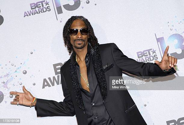 Rapper Snoop Lion poses in the Backstage Winner's Room at Nokia Theatre LA Live on June 30 2013 in Los Angeles California