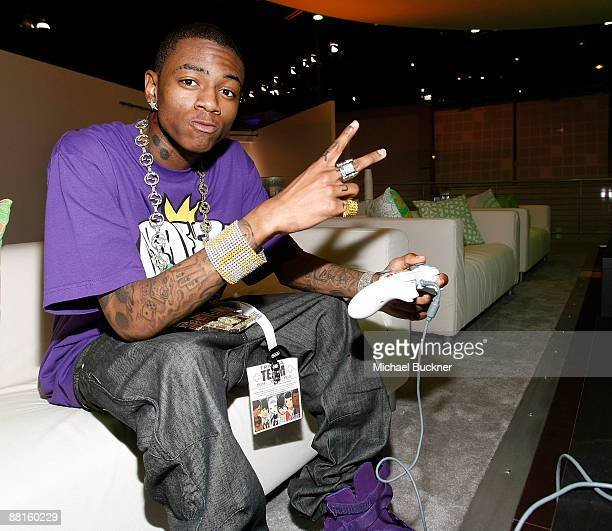Rapper Soulja Boy plays XBox at the XBox Booth at E3 Expo at Los Angeles Convention Center on June 2 2009 in Los Angeles California