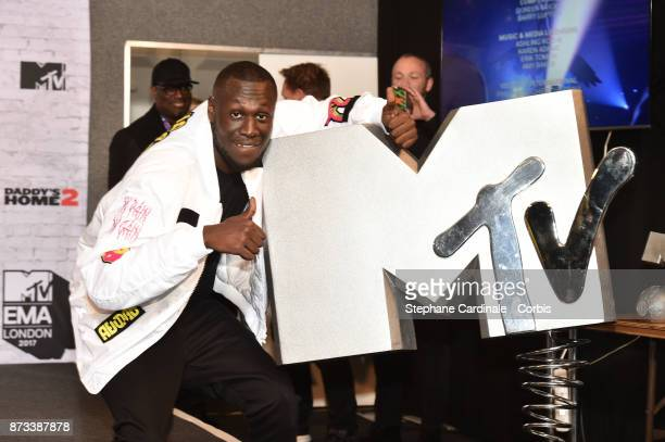 Rapper Stormzy poses in the Winners Room during the MTV EMAs 2017 held at The SSE Arena Wembley on November 12 2017 in London England