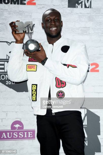 Rapper Stormzy poses with the award for the UK and Ireland Worldwide Act in the Winners Room during the MTV EMAs 2017 held at The SSE Arena Wembley...