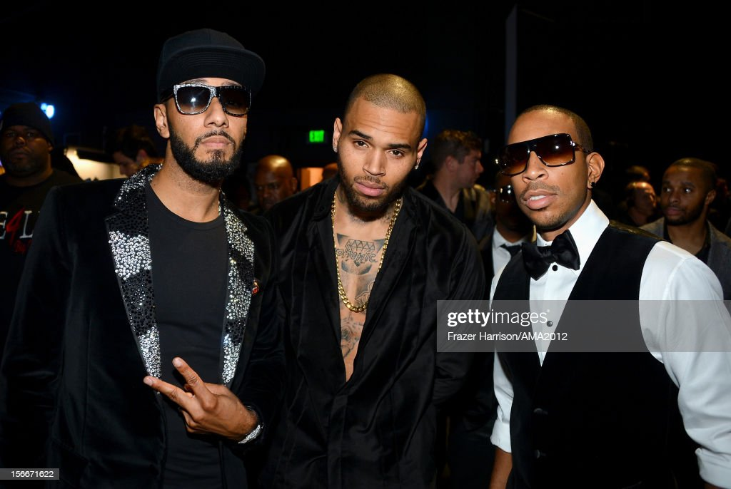 Rapper Swizz Beatz, singer Chris Brown and rapper Chris 'Ludacris' Bridges at the 40th American Music Awards held at Nokia Theatre L.A. Live on November 18, 2012 in Los Angeles, California.