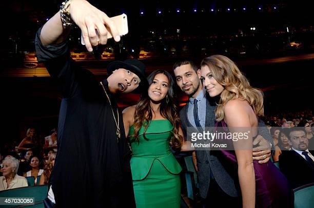 Rapper Taboo of The Black Eyed Peas actress Gina Rodriguez actor Wilmer Valderrama and actress Alexa PenaVega take a selfie at the 2014 NCLR ALMA...