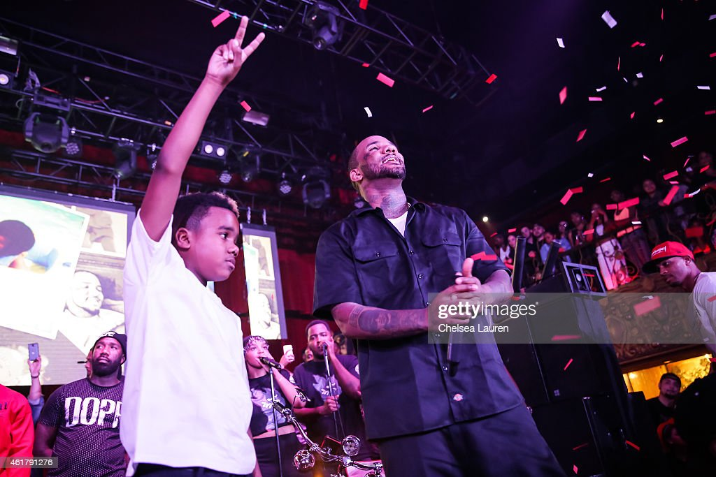 Rapper The Game and his son Harlem Taylor on stage at 'The Documentary' 10th anniversary party and concert on January 18, 2015 in Los Angeles, California.