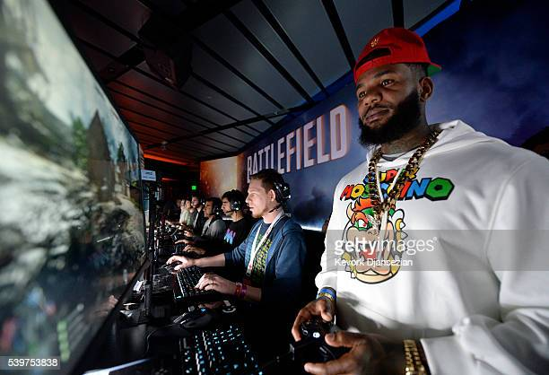 Rapper The Game plays the video game 'Battlefield 1' after a Electronics Arts news conference on June 12 2016 in Los Angeles California Thousands are...