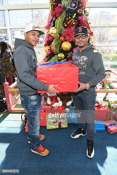 Rapper T.I. And Messiah Harris attend T.I.'s Holiday Caravan at Ryan Seacreat Studios at CHOA on December 22, 2016 in Atlanta, Georgia.