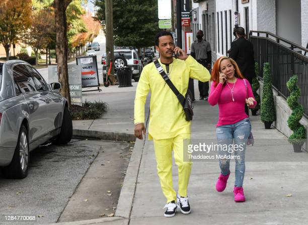 Rapper T.I and Tiny arrive at The 2 Chainz Quarantine Thick Brunch at Breakfast at Barney's on November 8, 2020 in Atlanta, Georgia.