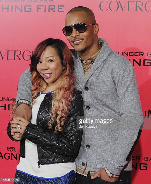 """Rapper T.I. And wife Tameka 'Tiny' Harris arrives at the Los Angeles Premiere """"The Hunger Games: Catching Fire"""" at Nokia Theatre L.A. Live on..."""
