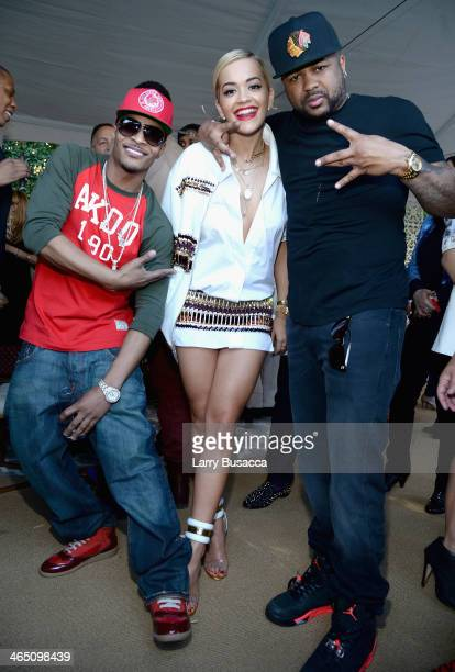 Rapper TI recording artist Rita Ora and guest attend the Roc Nation PreGRAMMY Brunch Presented by MAC Viva Glam at Private Residence on January 25...