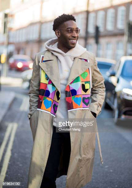 Rapper Tinie Tempah wearing beige JW Anderson trench coat, hoodie seen outside J.W. Anderson during London Fashion Week February 2018 on February 17,...