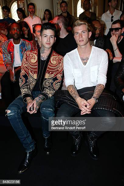 Rapper Travis Mills and Football player Loris Karius attend the Balmain Menswear Spring/Summer 2017 show as part of Paris Fashion Week on June 25...