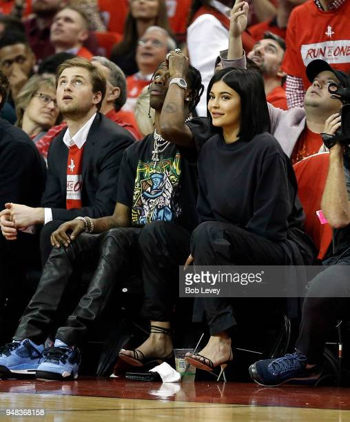 Rapper Travis Scott and Kylie Jenner watch from court side during Game Two of the first round of the Western Conference playoffs at Toyota Center on...