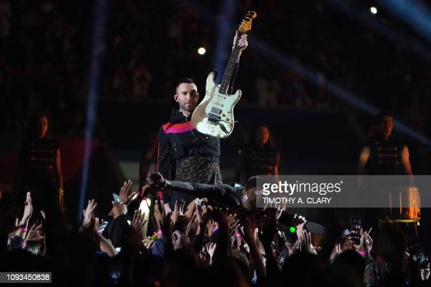 Rapper Travis Scott and lead vocalist of Maroon 5 Adam Levine perform during the halftime show of Super Bowl LIII between the New England Patriots...