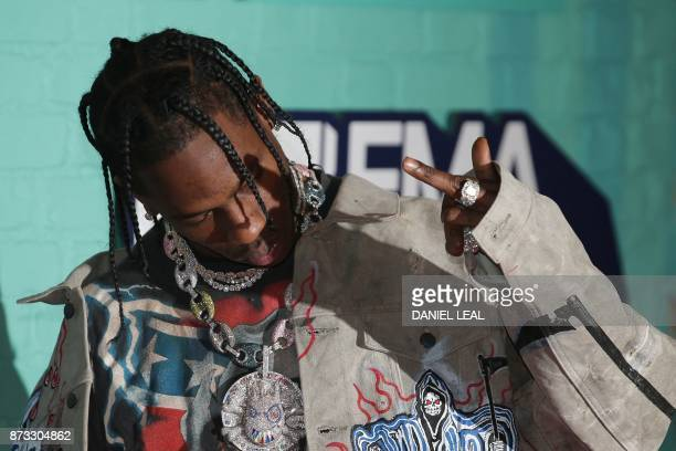 US rapper Travis Scott poses on the red carpet arriving to attend the 2017 MTV Europe Music Awards at Wembley Arena in London on November 12 2017 /...