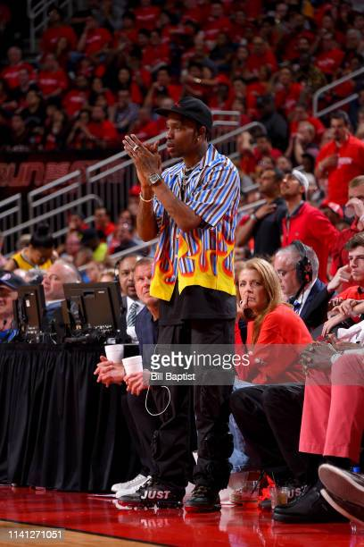 Rapper Travis Scott reacts to a play during the game between the Golden State Warriors and the Houston Rockets during Game Three of the Western...