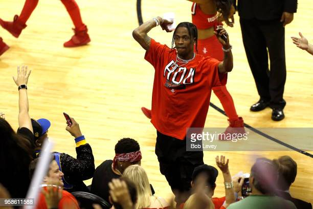 Rapper Travis Scott throws a tshirt in to the crowd in Game One of the Western Conference Finals of the 2018 NBA Playoffs between the Houston Rockets...