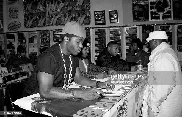 Rapper Treach, DJ Kay Gee and rapper Vin Rock of Naughty By Nature signs autographs and greets their fans at George's Music Room in Chicago, Illinois...