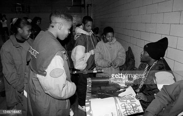 Rapper Treach of Naughty By Nature signs autographs and greets his fans during a celebrity basketball game in Chicago, Illinois in May 1993.