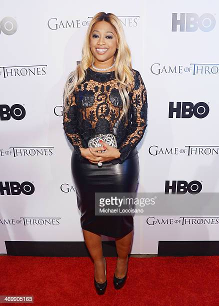 Rapper Trina arrives at the HBO Game of Thrones Catch the Throne NBA AllStar Event at Republic on February 16 2014 in New Orleans Louisiana