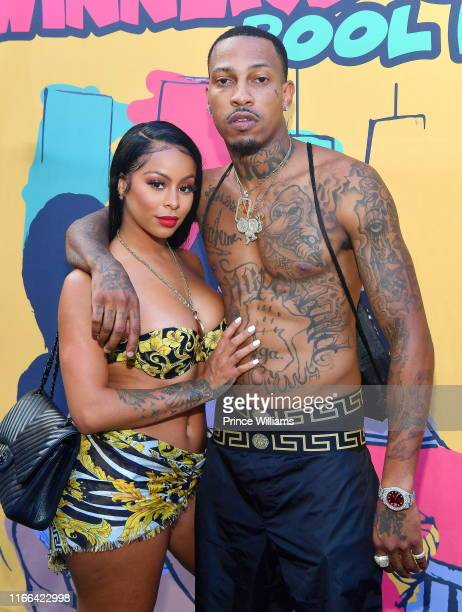 Rapper Trouble and Alexis Skyy attend Trouble's Winners Only Pool Party on August 4 2019 in Atlanta Georgia