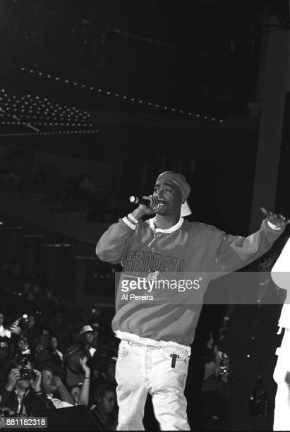 Rapper Tupac Shakur performs 'Out on Bail' onstage at the Madison Square Garden's Paramount Theater during the first Source Awards on April 25 1994...